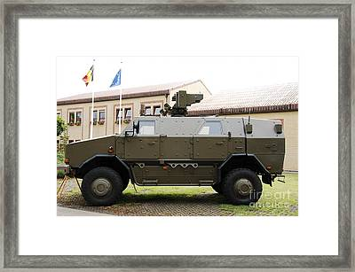 The Multi-purpose Protected Vehicle Framed Print by Luc De Jaeger