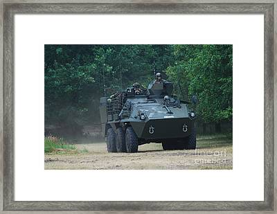 The Pandur Recce Vehicle In Use Framed Print by Luc De Jaeger