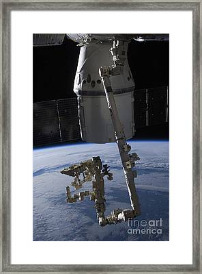 The Spacex Dragon Commercial Cargo Framed Print by Stocktrek Images