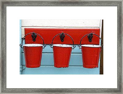 Three Red Buckets Framed Print by John Short