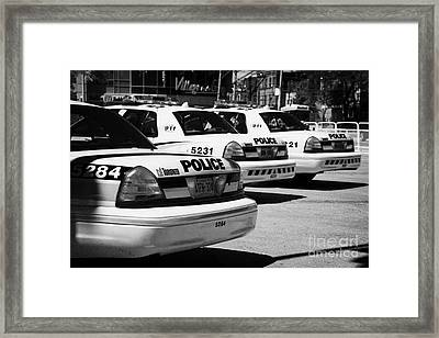 Toronto Police Squad Cars Outside Police Station In Downtown Toronto Ontario Canada Framed Print by Joe Fox