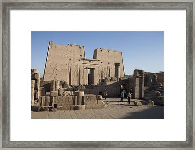 Tourists Walk Towards The Temple Framed Print by Taylor S. Kennedy