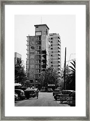 Varosha Forbidden Zone With Salaminia Tower Hotel Abandoned In 1974 Turkish Invasion Famagusta Framed Print by Joe Fox