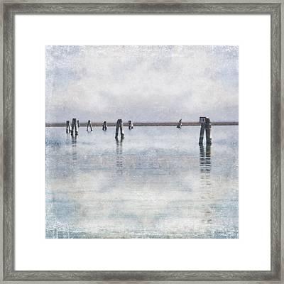 wood piles in the lagoon of Venice Framed Print by Joana Kruse
