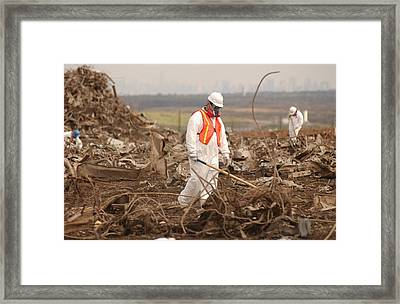 Workers At The Fresh Kills Landfill Framed Print by Everett