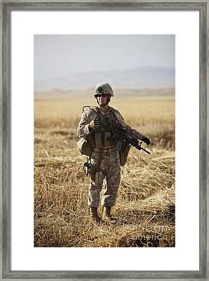 U.s. Marine Patrols A Wadi Near Kunduz Framed Print by Terry Moore