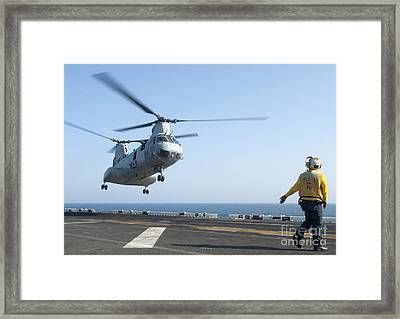 A Ch-46e Sea Knight Helicopter Prepares Framed Print by Stocktrek Images