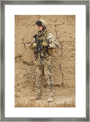 A German Army Soldier Armed With A M4 Framed Print by Terry Moore