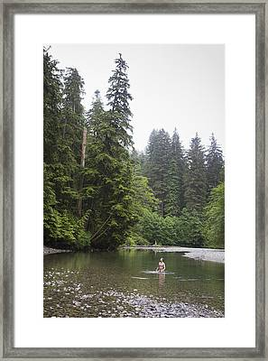 A Man Wades In A River In A Temperate Framed Print by Taylor S. Kennedy