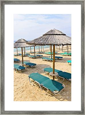 Beach Umbrellas On Sandy Seashore Framed Print by Elena Elisseeva