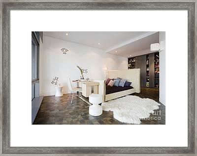 Bed And Desk In Bedroom Framed Print by Andersen Ross