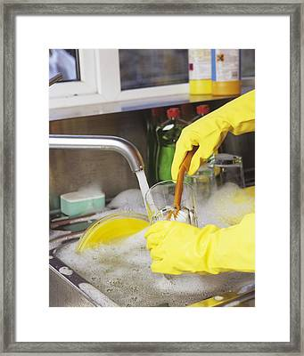 Cleaning The Dishes Framed Print by Carlos Dominguez
