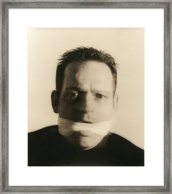 Gagged Man Framed Print by Cristina Pedrazzini
