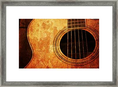 Old Guitar Framed Print by Nattapon Wongwean