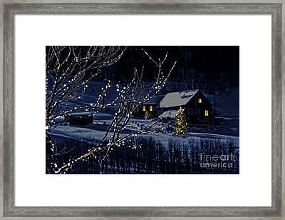 Snowy Winter Scene Of A Cabin In Distance  Framed Print by Sandra Cunningham