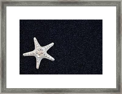 Starfish On Black Sand Framed Print by Joana Kruse