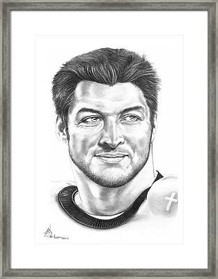 Tim Tebow Framed Print by Murphy Elliott
