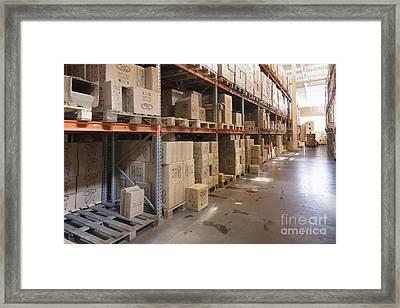 Warehouse Aisle Framed Print by Magomed Magomedagaev