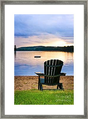 Wooden Chair At Sunset On Beach Framed Print by Elena Elisseeva