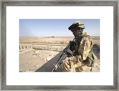 A British Army Soldier Provides Framed Print by Andrew Chittock
