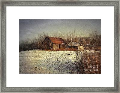 Abandoned Barn With Snow Falling Framed Print by Sandra Cunningham