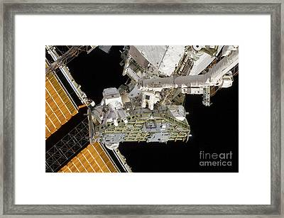 Astronauts Working On The International Framed Print by Stocktrek Images