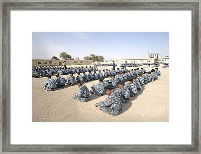 Iraqi Police Cadets Being Trained Framed Print by Andrew Chittock