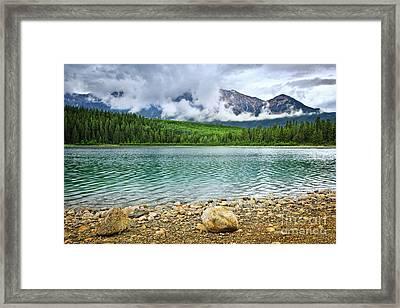 Mountain Lake In Jasper National Park Framed Print by Elena Elisseeva