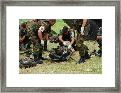 Soldiers Of A Belgian Infantry Unit Framed Print by Luc De Jaeger