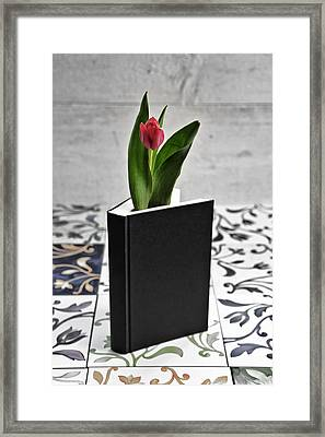 Tulip In A Book Framed Print by Joana Kruse