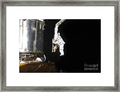 Astronaut Working On The Hubble Space Framed Print by Stocktrek Images