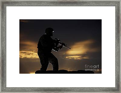 Partially Silhouetted U.s. Marine Framed Print by Terry Moore