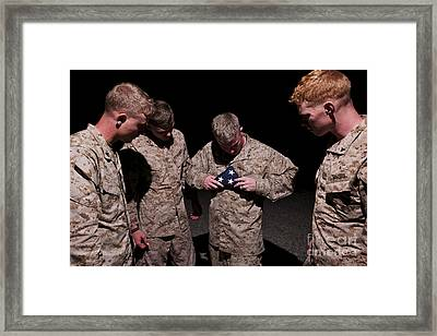 U.s. Marines Fold The American Flag Framed Print by Terry Moore