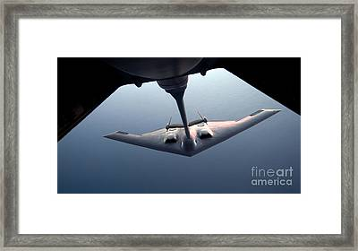 A B-2 Spirit Bomber Conducts Framed Print by Stocktrek Images