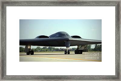 A B-2 Spirit Taxis Onto The Flightline Framed Print by Stocktrek Images