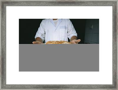 A Baker Shows His Fresh Loaves Framed Print by Heather Perry