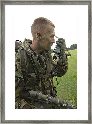 A British Army Soldier Radios Framed Print by Andrew Chittock