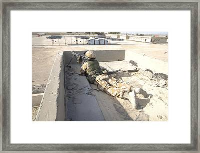 A British Soldier Provides Security Framed Print by Andrew Chittock