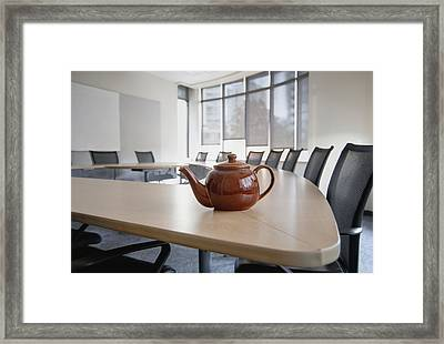 A Brown China Teapot On Boardroom Table Framed Print by Marlene Ford