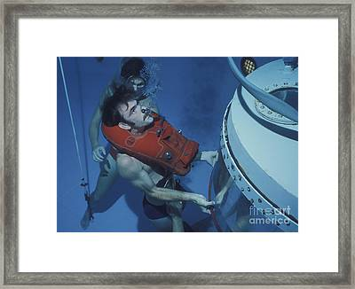 A Buoyant Ascent Training Student Holds Framed Print by Michael Wood
