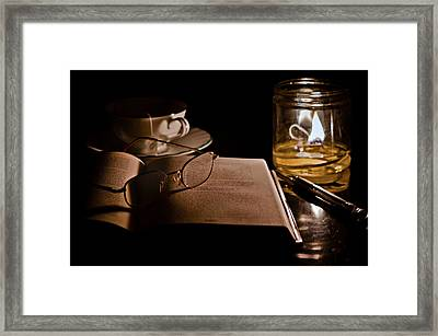 A Candlelight Scene Framed Print by Lori Coleman