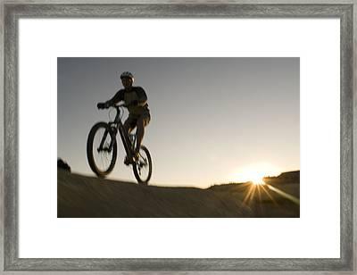 A Caucasian Man Mountain Bikes Framed Print by Bobby Model