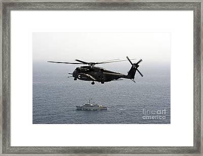 A Ch-53 Sea Stallion Flies Framed Print by Stocktrek Images