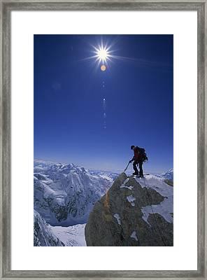 A Climber With An Ice Axe Above Snow Framed Print by Bill Hatcher