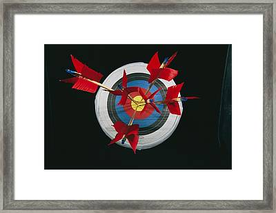 A Close View Of Arrows Stuck In A Bulls Framed Print by Richard Nowitz