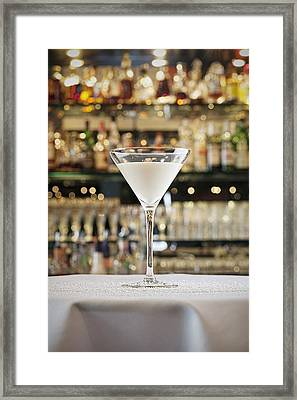 A Cocktail On A Table Framed Print by Larry Washburn
