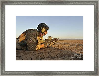 A Combat Rescue Officer Provides Framed Print by Stocktrek Images
