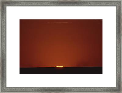 A Contrast Shot Of Red Sky And Dark Framed Print by Kenneth Garrett