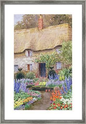 A Cottage Garden In Full Bloom Framed Print by John Henry Garlick