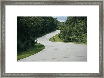 A Cyclist On A Scenic Drive In Gatineau Framed Print by Michael S. Lewis